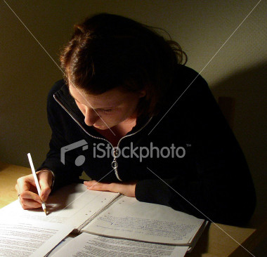 File:Stock-photo-119271-young-woman-doing-her-homework.jpg